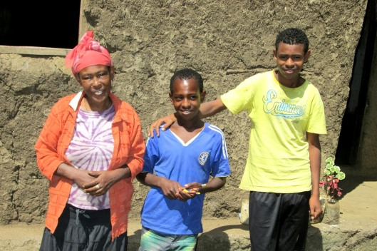 Alemayehu, with his mother and brother